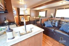 The Wildwood 262BHXL is a great bunkhouse model with a booth dinette and sofa slide creating a lot of space in the living area. This model features two double bunks, with the dinette and sofa, it can sleep up to eight adults. The second entrance to the bathroom serves as a mud room and easy access in and out of the camper. This is a great light weight bunkhouse travel trailer! {WW128}