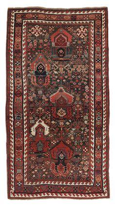 Sauj Bulaq Kurdish flame-palmette rug, northwest Persia, 19th century.