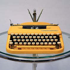 The Smith Corona Skyriter was introduced in 1949 to rival the sleek, low profile dimensions of the portable Hermes Rocket. Its tiny footprint, no-nonsense mechanics and streamlined aesthetics make this laptop-sized typewriter a gorgeously well-thought-out work of art custom painted by Kasbah Mod.