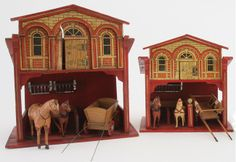 "Pair of Gottschalk stables: painted and lithographed paper on wood construction - the same basic style varying in elaborateness of detail as size increases - note the similarity of paper design; both outfitted with carts and 2 horses (equines have damage and repairs)10.5"" & 11.5"" w."