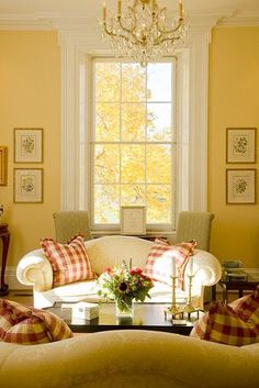 touches of dark red, elegant, yet country feel, yellow living room.
