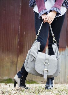 I have this in black and not only is it a great camera bag but works as an everyday purse