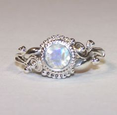 Oh. My. Gosh.  This non-traditional ring thing is starting to really grow on me...  Engagement Rings: The Enigma of Moonstone Engagement Rings