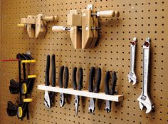 designs for tool holder | Our Peg Board rack keeps tools ready for work.