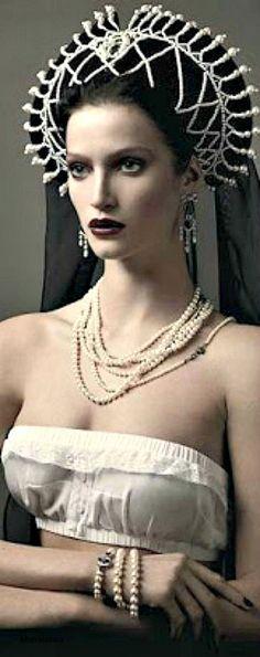 Dolce & Gabbana top; Dior Joaillerie, Van Cleef & Arpels; Cartier accessories