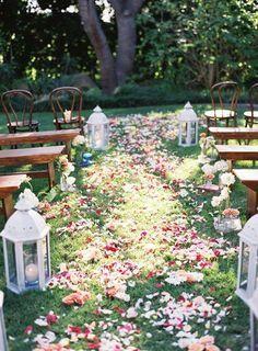 Garden wedding ceremony decor idea - large lanterns and flower petal aisle {NLC Productions}