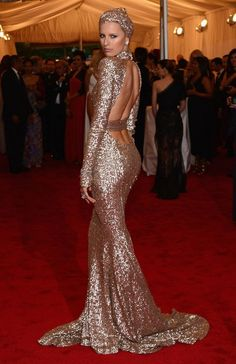 long sparkly dress with an open back - pretty but minus the head thingy