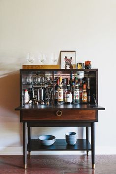 This bar from West Elm closes to hide your extensive bitters collection when you frat friends come over and just want to drink cheap beer.