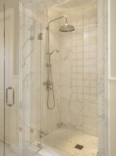 Fantastic shower with rain shower head, marble tiles shower surround