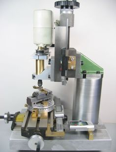 A small homemade milling machine for desktop machining from column to spindle center and from milling table to spindle clearance)