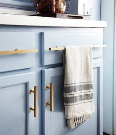 love colored kitchen cabinets. the brass pull are also amazing.