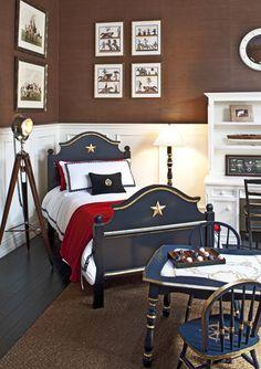 Spotlight floor lamp, navy bed, brown grass cloth wallpaper