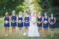 Blue (not really navy) mismatched bridesmaids- also, Cait you should check out the whole wedding.