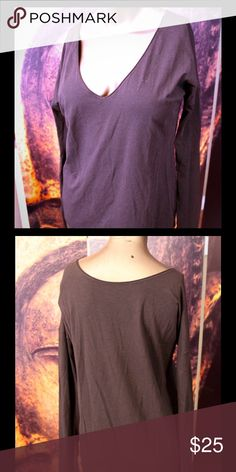 Lululemon stretchy long sleeve reversible Tshirt It can be worn frontwards and backwards if u want the vneck to be in the back. Also has lulu's signature thumb holes:) lululemon athletica Tops Tees - Long Sleeve