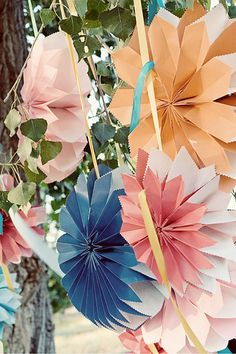 Paper Flowers.  In bright colors this could go with a fun Mexican theme. . .