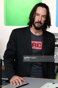 News Photo : Actor Keanu Reeves is seen posing by his book...