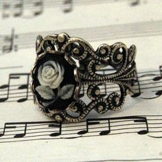 Rose Cameo Ring by ragtrader on Etsy $17.00. <3