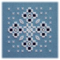 Snowflake - Charted in two versions: a traditional white-on-white version with metallics and an icy blue Caron version on coloured fabric.