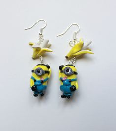 handmade polymer clay minion earrings with the tongue out.
