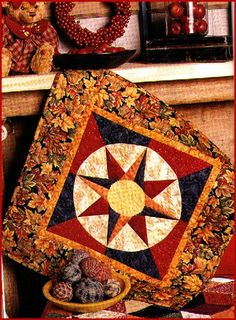"""Autumn Mariner's Compass from """"Bold, Black & Beautiful Quilts"""", AQS 2004. Paper pieced on a coffee filter. Easy machine appliqued center."""