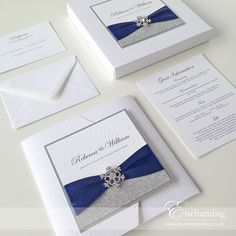 Navy Wedding Invitations | The Cinderella Collection - Boxed Pocketfold Invitation | Featuring silver glitter paper, luxury navy blue ribbon and snowflake embellishment | Luxury handmade wedding invitations and stationery #byenchanting