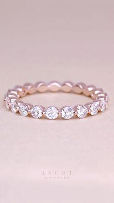 A custom rose gold thin diamond eternity wedding band, featuring fine white diamonds. Ascot Diamonds #ascotdiamonds