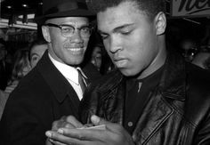 In this March file photo, heavyweight boxing champion Muhammad Ali, right, is shown with black muslim leader Malcolm X outside the Trans-Lux Newsreel Theater in New York, after viewing the screening of a film about Ali's title fight with Sonny Liston.