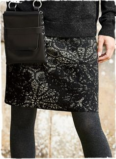 Lacy pinwheels twirl across the straight-falling skirt, jacquard knit in shadowy hues of grey and charcoal pima.
