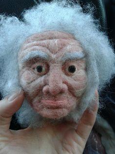 Old man felt puppet head.