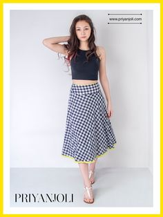 The Gingham Bias Skirt has been crafted from pure cotton from the looms of Bengal. The lightweight fabric combined with a patterned texture and plaid design creates an aura of understated elegance.  This indigo and white skirt is simple and striking; the Bias cut flares beautifully and gives you an airy feel. The fluorescent piping adds a pop of colour and will fit right into your summer wardrobe. Wear it with a crop-top or throw on a collared shirt and head to the office.
