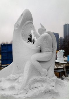 Here's a snow sculpture of Batman fighting a shark. You're welcome.