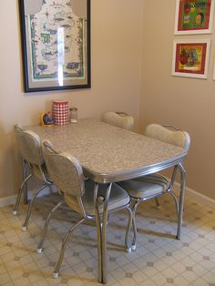 "Vintage Dinette Set - we had a set just like this when we were kids. The bottom of a couple of the chairs would pop up like a ""booster chair""!"