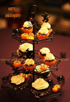 Happy Halloween! A last picture of my fun spider web stand. Intensely fudgy, chocolate cupcakes (a Martha Stewart recipe!) with a light and very buttery vanilla buttercream; sure to tame even the most evil of witches and goblins!