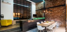 Open plan kitchen, living and dining area of a contemporary two-bedroom apartment in Budapest