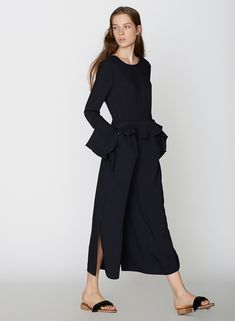 Honestly, I don't think ruffles have everlooked this modern and chic. Designer Goen Jonghasincorporated the ruffle, into her tailoredsilhouettes, in such a crisp and architectural way, it's no wonder they've become asignature element of her eponymous label. I love the addition