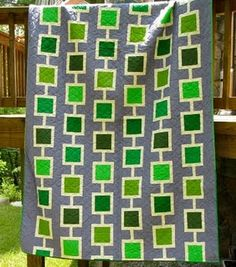 Great idea for modern quilt using Bella Solids, love the grey background.