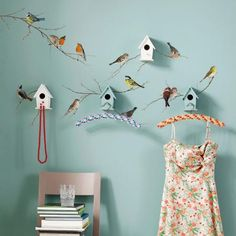 ...birds land on my walls.  These are the sweetest decals.  Must.  Have.  Them.  Equally sweet are the birdhouses painted the same shade as the wall.