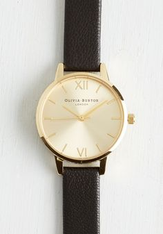 Olivia Burton Undisputed Class Watch in Gold/Black - Petite. Become known as the arbiter of good taste by making this watch from Olivia Burton your everyday accessory! #black #modcloth