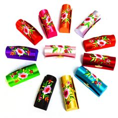 Gorgeous colourful lipstick cases with mirror inside. http://www.secretfashionfixes.ie/p/silk-brocade-embroidered-lipstick-case-with-mirror/p-lipstickcase