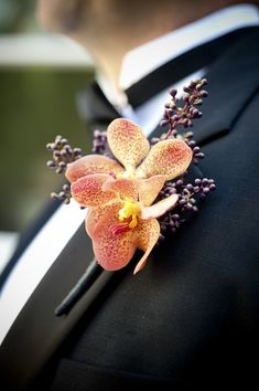 orchid boutonnier of groom - wedding photo by top South Carolina wedding photographer Leigh Webber