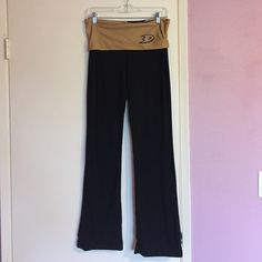 NHL Anaheim Ducks Black Yoga Pants black NHL Anaheim Ducks yoga pants with a gold fold-over waist. small Ducks logo on the front left waist and large Ducks logo on the back. in great condition! NHL Concepts Sport Pants