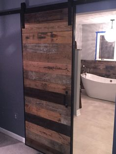 Modern Rustic Sliding Barn Door with Metal Trim by RecoWarehouse.com. Located in San Diego!