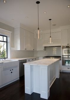 A Vancouver Kitchen And Island Lit By Niche Modern Bell Jar Pendant Lights