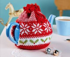 Start your Christmas crafting early with our festive tea cosy and baubles- free pattern