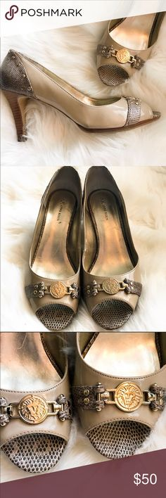 Anne Klein Patent Leather Peep Toe Pumps And Klein patent leather peep toe pumps size 11. Some normal wear all around small scuffs and back and scratches on the inside but still pretty good condition. Item number is written on bottom of one. The shoes are known for comfort. Has gold and Klein emblem in front. He'll is approximately 3 1/2 inches. Anne Klein Shoes Heels