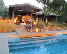 Google Image Result for http://www.susancohangardens.com/blog/wp-content/uploads/2010/10/outdoor-kitchen-and-firepit.jpg