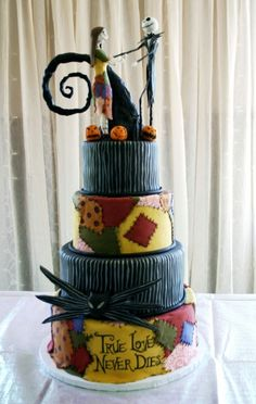 Nightmare Before Christmas inspired wedding cake with fondant patchwork and hand sculpted edible characters