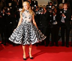 Paris Hilton hits the Cannes 2014 red carpet. http://www.vogue.in/content/star-spotting-cannes-2014
