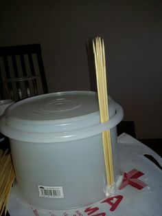 Use the cut out lid to secure the skewers so that they don't fall out.