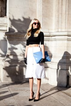 Leather gloves with short sleeved sweater and a clutch